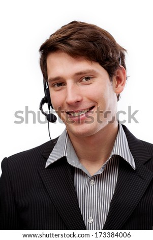 Young handsome telemarketer in headphones smiling - stock photo