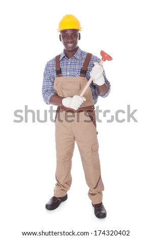 Young Handyman Holding Plunger Over White Background - stock photo