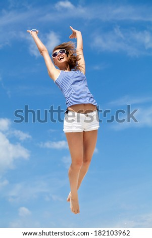 young happiness woman is jumping against blue sky - stock photo