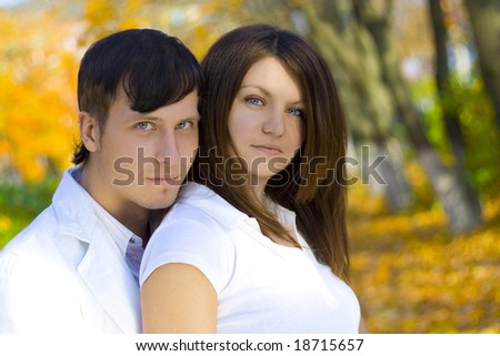 young happing couple in autumn park - stock photo