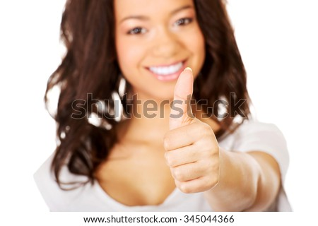 Young happy african student woman showing thumbs up.
