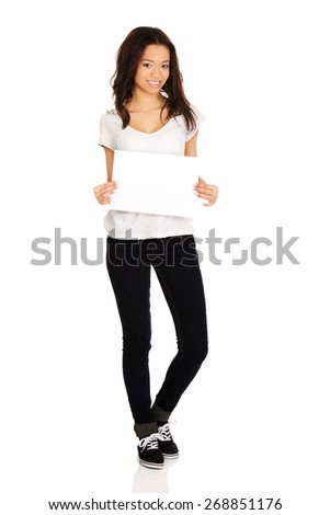 Young happy african teen with blank paper. - stock photo