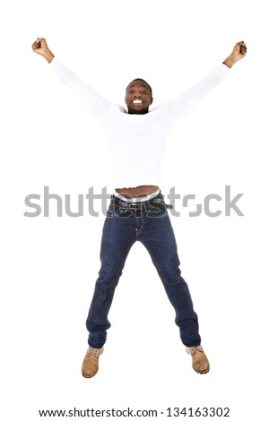 Young happy afro american man jumps in joy over white background. - stock photo
