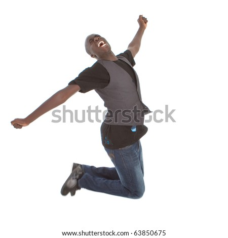 Young happy afro american teenager jumps in joy over white background. - stock photo