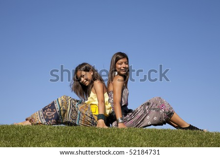young happy and loving sisters smiling - stock photo