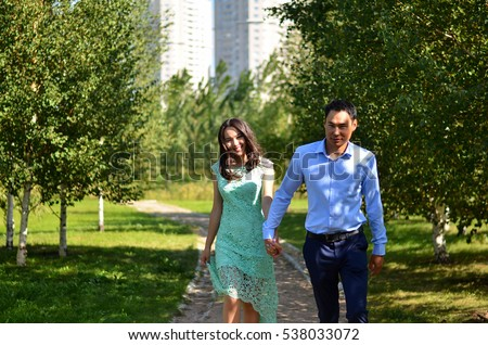 https://thumb9.shutterstock.com/display_pic_with_logo/3978596/538033072/stock-photo-young-happy-asian-couple-walking-in-the-park-538033072.jpg