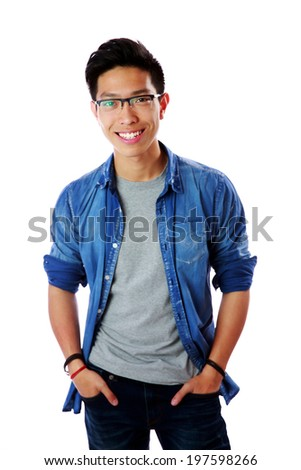 Young happy asian man standing over white background