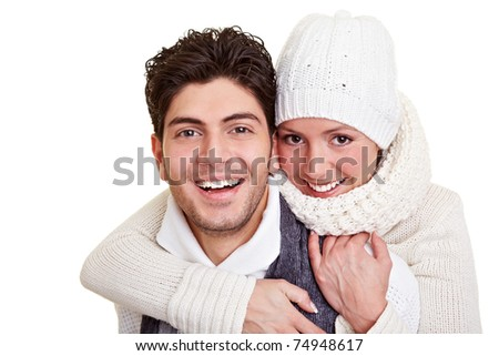 Young happy attractive couple in winter clothing - stock photo