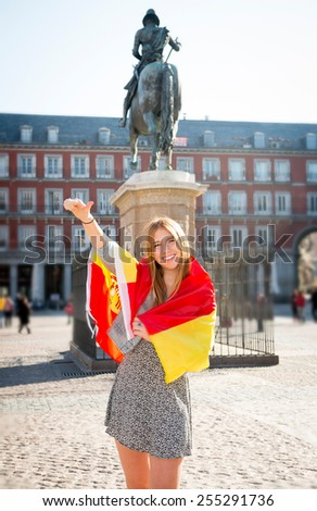 young happy attractive exchange student girl having fun in town visiting Madrid city showing Spain flag having fun outdoors in tourism and travel vacation concept - stock photo