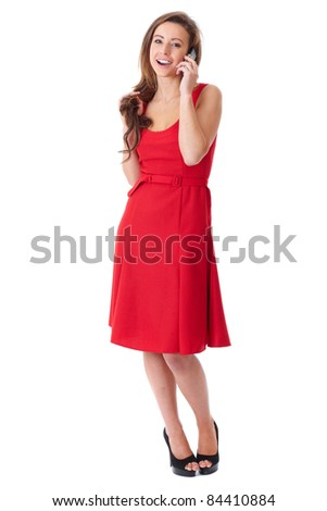 Young happy attractive female in red dress chat over mobile phone, shoot over white background