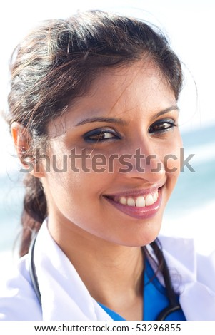 young happy attractive female nurse portrait outdoors - stock photo