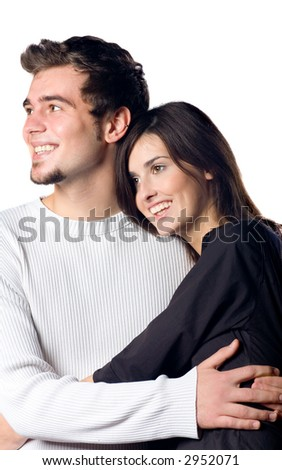 Young happy attractive smiling couple hugging, isolated on white background