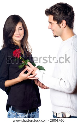 Young happy attractive smiling couple with rose isolated on white background