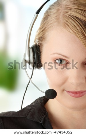 Young happy beautiful customer service operator girl in headset - stock photo