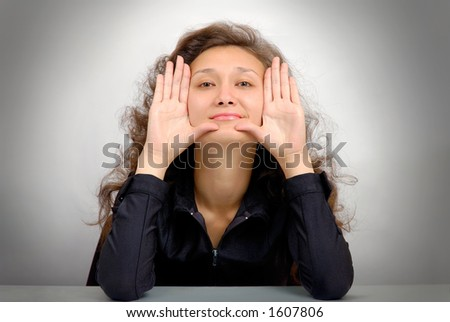Young happy beautiful woman showing her palms isolated on white - hygiene concept - stock photo