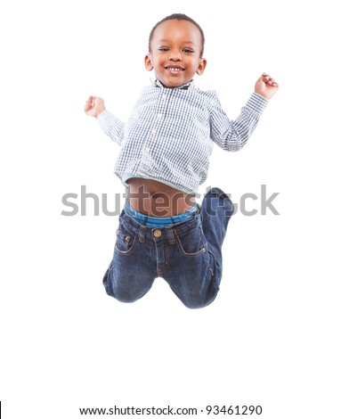 Young happy black boy isolated over a white background jumping in joy. - stock photo