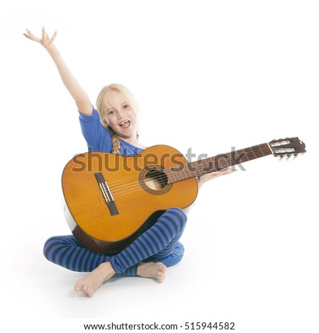young happy blond girl in blue with guitar against white background