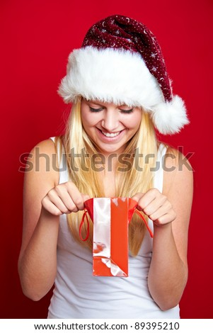 young happy blond girl with christmas present - stock photo
