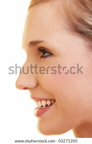 Young happy blonde woman in profile view - stock photo