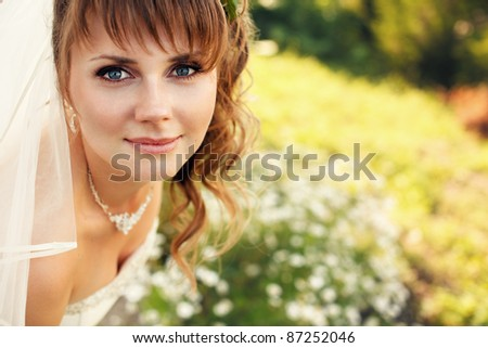 Young happy bride outdoors - stock photo