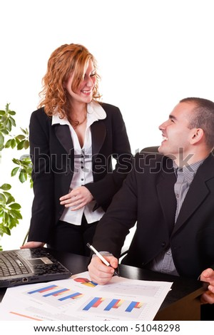 young happy business colleagues talking and laughing while working