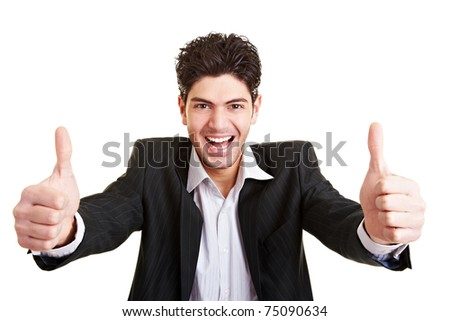 Young happy business man holding both thumbs up - stock photo