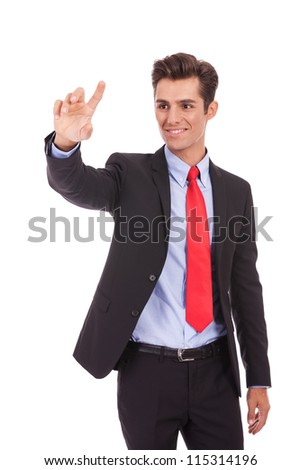 young happy business man selecting something on an imaginary screen - stock photo