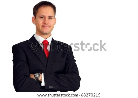 Young happy business man with his arms crossed - stock photo