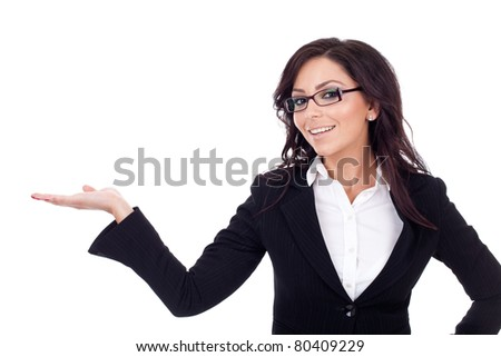 Young happy business woman presenting something on her hand, isolated on white