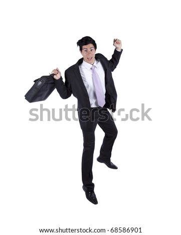 young happy businessman jumping isolated on white (some motion blur) - stock photo