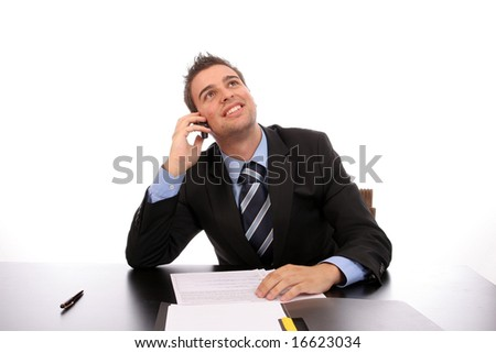 Young happy businessman on the phone, over white background