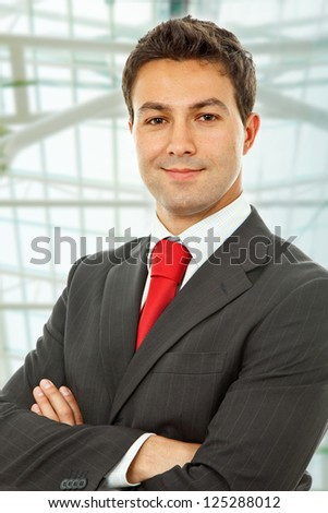 young happy businessman portrait at the office - stock photo