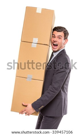 Young happy businessman with box for moving into a new office. Studio shot, isolated on a white background - stock photo