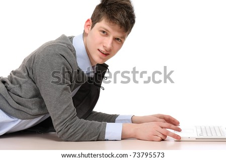 Young happy businessman with laptop - stock photo