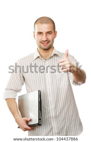 Young happy businessman with laptop showing ok, isolated on white - stock photo