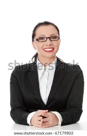 Young happy businesswoman behind the desk, isolated - stock photo