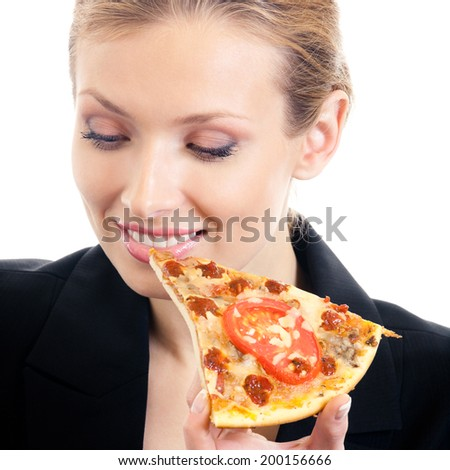 Young happy businesswoman eating pizza, isolated on white background