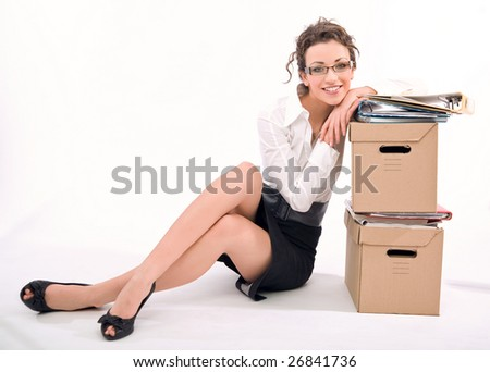 Young happy businesswoman next to pile of documents, lots of copy space - stock photo