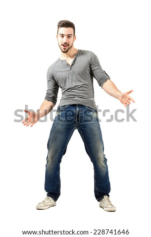 Young happy cheerful man with spread open arms. Full body length isolated over white background. - stock photo