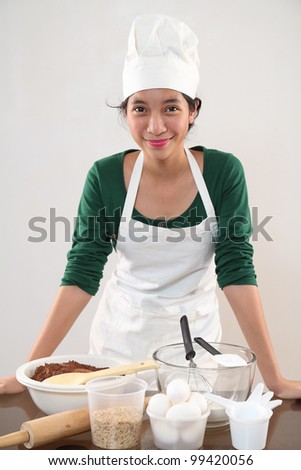 Young happy chef in the kitchen. - stock photo