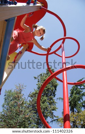 young happy child girl having fun on outdoor playground - stock photo