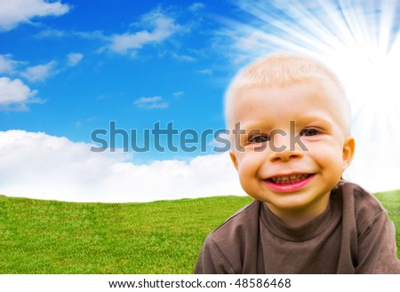 Young happy child in the spring landscape - stock photo