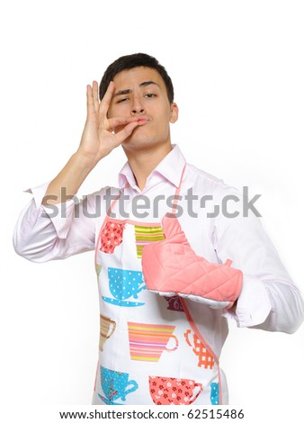 Young happy cook man in apron smiling and leathing. isolated on white background