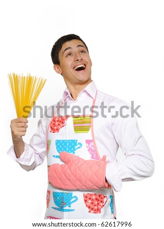 young happy cook man with spagetti pasta. isolated on white background