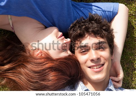 Young happy couple at the park - stock photo
