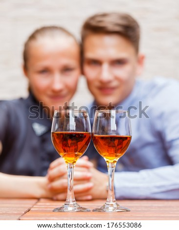 Young happy couple drinking wine in a restaurant