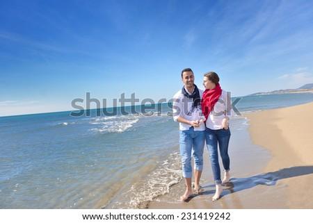 young happy couple enjoying at sea - stock photo