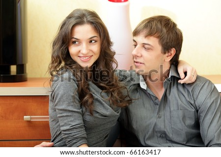 Young happy couple hugging at home - stock photo