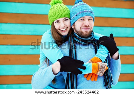 Young happy couple in love outdoors in the winter - stock photo