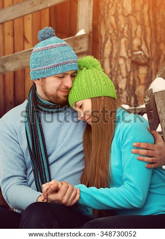 Young happy couple in love outdoors in the winter